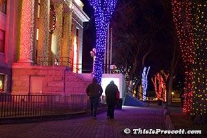 Couple enjoying Courthouse Christmas lights.